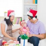Asian family celebrating christmas — Stock Photo #72991079