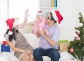 Asian family celebrating christmas — Stock Photo