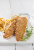 Fried fish fillet with french fries — Stock Photo