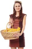 Young woman with a basket of corn — Stock Photo