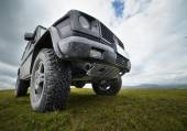 Offroad car in the mountains — Stock Photo