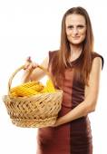 Young woman with a basket of corn — Foto Stock