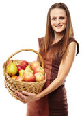 Young woman with a basket of fruits — Stock Photo