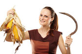 Woman with reaping hook and corn — Stock Photo