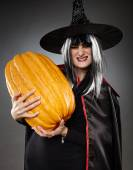 Sorcerer with pumpkin — Stock Photo