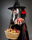Sorcerer offering a poisoned apple — Stock Photo