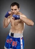 Kickboxer in guard stance — Stock Photo