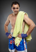 Bruised fighter with towel — Photo