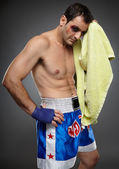Bruised fighter with towel — Stock Photo