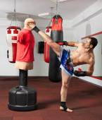 Kickbox fighter working with the dummy — Stock Photo