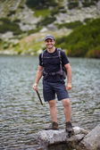 Hiker by the lakeside — Stock Photo