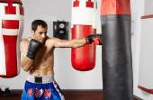 Boxer with the punching bag — Stock Photo