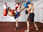 Kickbox fighters sparring in the gym — Foto Stock