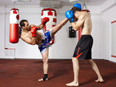 Kickbox fighters sparring in the gym — Zdjęcie stockowe