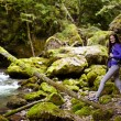 Hiker lady with backpack on trail — Stock Photo #53491135