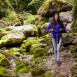 Hiker lady with backpack on trail — Stock Photo #53491145