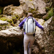 Hiker lady with backpack on trail — Stock Photo #53491185