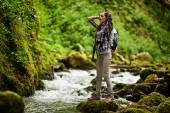Young woman hiker by the river — Stock Photo