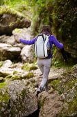 Hiker lady with backpack on trail — Stock Photo