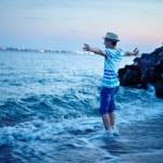 Teenager on the sea shore — Stock Photo #55069915