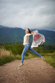 Portrait of a young woman outdoor dancing — Stock Photo