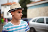 Teenage boy with hat outdoor — Stock Photo