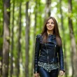 Teenage girl walking in the forest park — Stock Photo #55881627