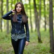 Teenage girl walking in the forest park — Stock Photo #55881637