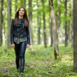 Teenage girl walking in the forest park — Stock Photo #55881647