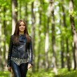 Teenage girl walking in the forest park — Stock Photo #55881675