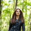 Teenage girl walking in the forest park — Stock Photo #55881731