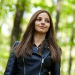 Teenage girl walking in the forest park — Stock Photo #55881753