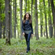Teenage girl walking in the forest park — Stock Photo #55881757
