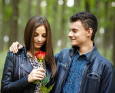 Teenager giving a flower to his girlfriend — Foto Stock