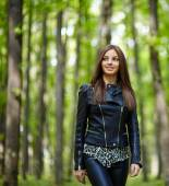 Teenage girl walking in the forest park — Stock Photo