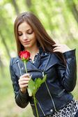 Beautiful girl with a rose — Stock Photo