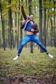 Young man jumping for joy — Stock Photo