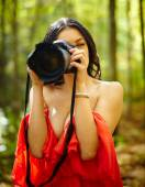 Young woman taking photos — Stock Photo