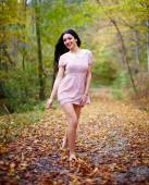 Barefoot woman in the forest — Stock Photo