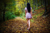 Woman walking barefoot in forest — Stock Photo