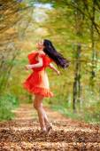 Woman in red dress in forest — Stock Photo