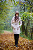 Beautiful woman walking in forest — Stock Photo