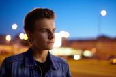 Teenage boy in urban environment at night — Stock Photo