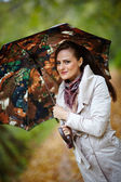 Woman with umbrella in forest — Stock Photo