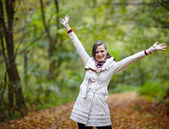 Happy young woman in forest — Stock Photo