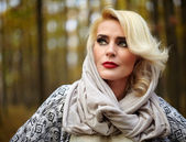 Blonde woman outdoor in forest — Stock Photo