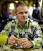 Single man in a restaurant — Stock Photo