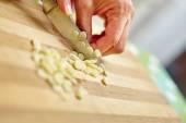 Woman chopping garlic — Stock Photo