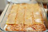 Homemade lasagna in tray — Stock Photo