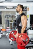 Biceps workout with barbell — Stockfoto